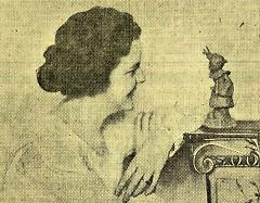 Gert Van Houten, age 26, looking at a statuette of Little Gert