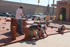 Workers placing bricks on Grandville Avenue
