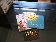 """""""Does This Book Make My Brain Look Big?"""" and """"Under the Sun,"""" written by CYC students."""