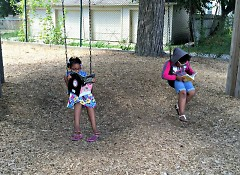 Children reading on swings at the Creative Youth Center