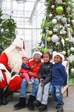 Children visit Santa Claus at the Downtown Market