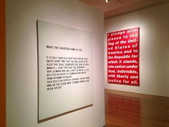 At left, What This Painting Aims to Do by John Baldessari, at right, Untitled [Pledge] by Barbara Kruger