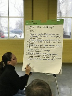 Jackie Hernandez writes down comunity imput at Civil Rights Town Hall