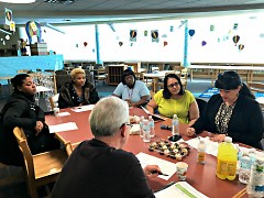 Stout meets with community members to explain how they can apply for a Neighborhood Match Fund.