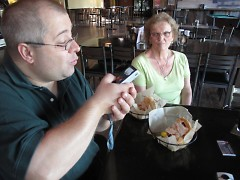 Chris documents his Founders Grandwich while sponsor and JGR Real Estate coworker Elaine Williams looks on