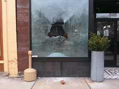 A smashed window at The Winchester, 648 Wealthy St. SE