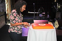 Managing Editor, Kiran Sood Patel cutting The Rapidian's birthday cake
