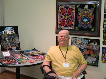 Patient artist with his work