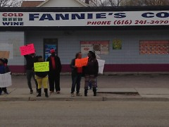 Protesters line up in front of Fannies Corner Store