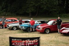 Grand Rapids Street Racers members pose in front of their cars.