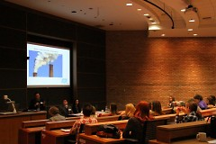 Attendees engaging in a panel discussion during the symposium