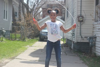 Lundyn jumps rope after an egg hunt with her family.