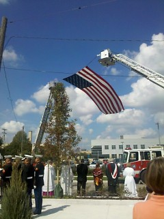 Interfaith clergy at St. Andrew's Cathedral bless first responders' vehicles