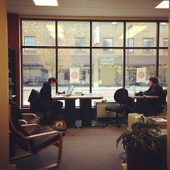 Rapidian interns working in the reporters lounge