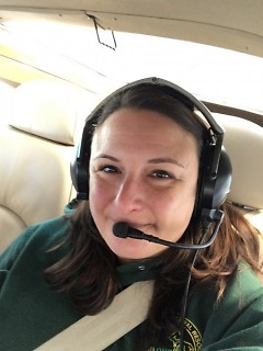 Jennifer Kleitch, a DNR wildlife biologist, takes to the skies for the state's annual elk survey.