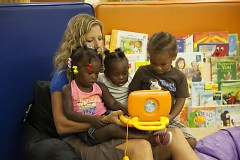 Jodi Scholma, Mel Trotter's Children's Advocate, reads to children