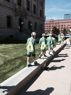 Campers take the scenic route through downtown