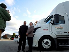 Feeding America West Michigan CEO Ken Estelle poses with Doug Meijer, whose company donated three trucks.