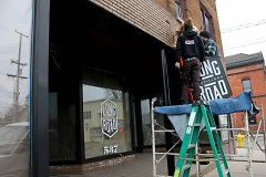 Signs and last touches are going up at Long Road Distillers as they prepare to open