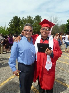 Mario, left, and a high school graduate