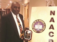 Michael Scruggs receiving a service award from the NAACP in 2014.  He is running for Kent County Sheriff in the 2016 election.