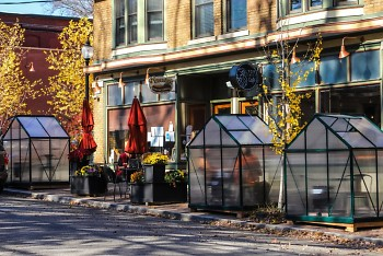 Greenhouse-like enclosures outside Lyon Street Café, built to keep outdoor diners warm.