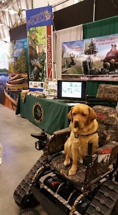 When Program Coordinator Tom Jones is out promoting MiOFO among outdoorsmen, his service dog Baxter always comes along.