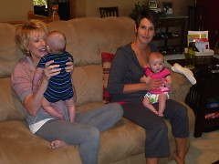 Volunteers help mothers with newborns, as the family adjusts to the new addition.