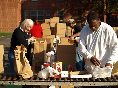 Some of the volunteers are sorting & boxing all of the donated items.