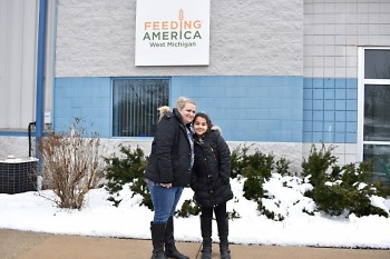 Olivia and her mother visited the Feeding America West Michigan warehouse to see firsthand how the food bank operates.