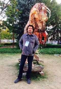 "Artist Daniel Oropeza with his ArtPrize 9 entry ""Lux Maximus"""