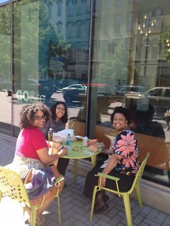 Downtown workers enjoying the GoSite outdoor seating on a sunny day
