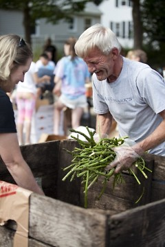 Volunteers give away asparagus by the handful at Parkview Elementary School's Mobile Pantry in July.