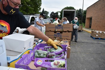 A volunteer prepares food for distribution at Parkview Elementary.
