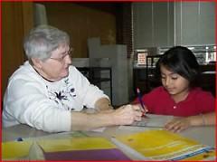 Sister Pat Kennedy tutoring.