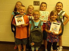 Children with Literacy Backpack materials