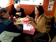 Customers enjoying their meals at Tacos El Cuñado.
