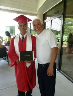 Rechy Rodriguez on his graduation day with Ricardo Martinez (right)