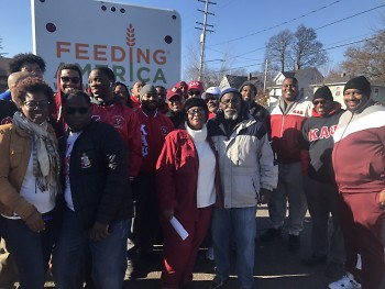 Beverly, Tyrone and volunteers, including those from Kappa Alpha Psi.