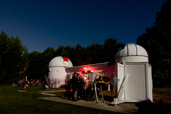 Veen Observatory visitors in line for a portable telescope viewing, during a previous year.
