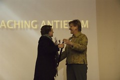 Grand Rapids Historical Society President Gina Bivins presents Baxter Award to Rebecca Smith-Hoffman at Gerald R. Ford Museum