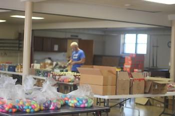 Executive Director Rob Summerfield sorts food and egg baskets.