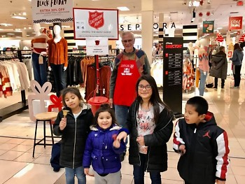 Children enjoy ringing bells with the Kentwood Rotary Club
