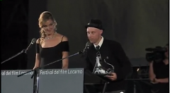 Potrykus accepting the award for Best New Director at this year's Locarno International Film Festival.