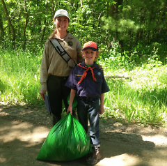 Bradlee Gehlhoff, a second-grader, shows off the bag filled with invasive garlic mustard.