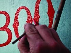 Sign Painter Sean Barton of Sean Barton Signs hard at work