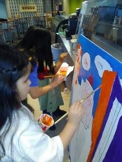 A Kids Summit attendee paints the Grand Rapids skyline.