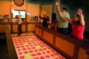 Puzzles and games at Mindbender Mansion exhibit
