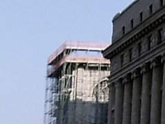 A closer look at the scafolding surrounding tower.