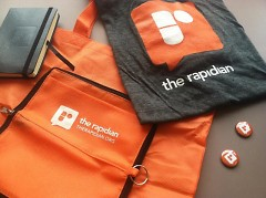 The winner receives a swag bag with a reusable zip tote, notebook, t-shirt, and pins.